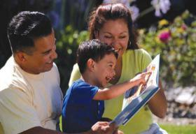 latinx family child with book